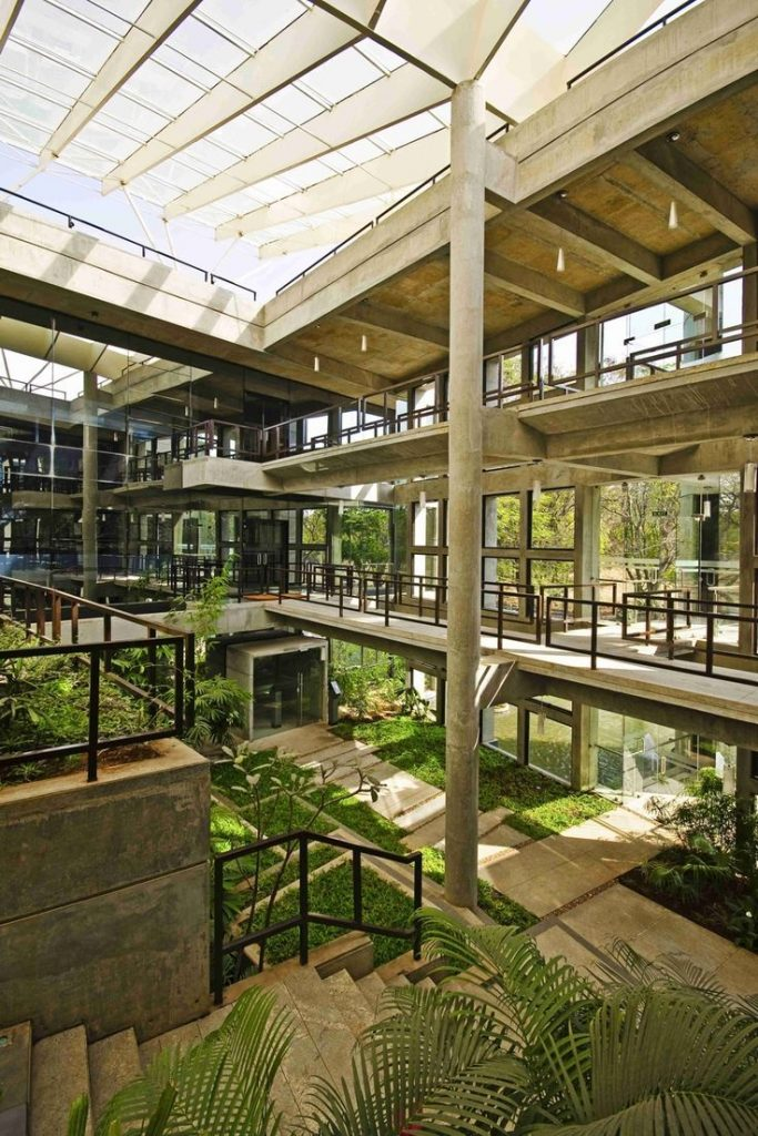 CORE architecture plants a tropical garden on a concrete hillock in this energy-...