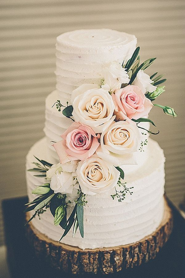 Like the flowers and frosting texture. Would add cake topper.
