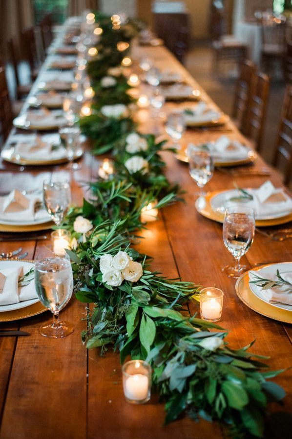 Rustic garland and candle covered wedding tables: www.stylemepretty... Photograp...