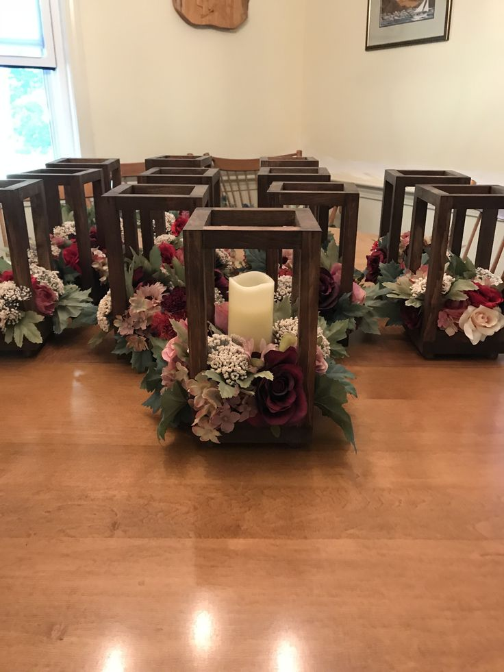 Pick up or local drop off only. No shipping. Wooden lantern centerpieces with fl...