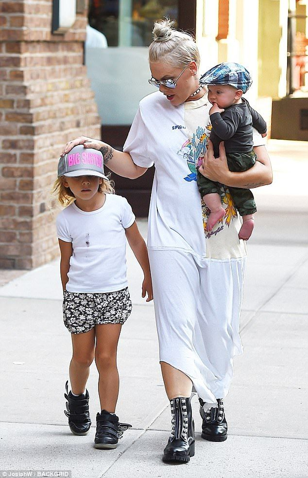 Dress to impress: Pink looked slim in a long cream and white T-shirt dress, whic...