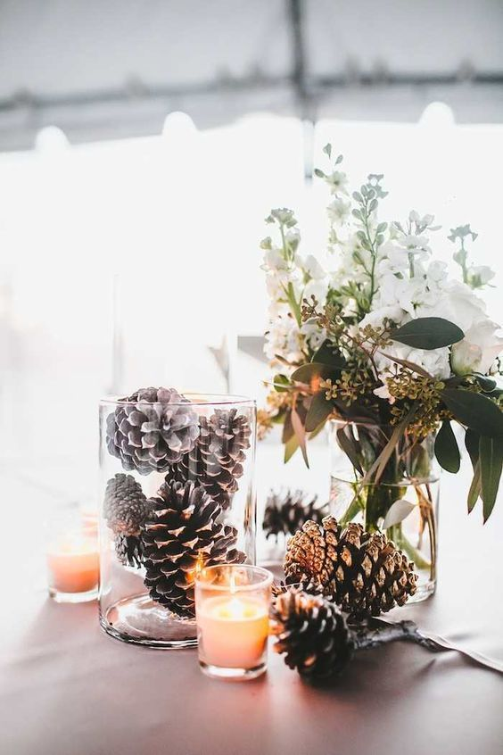 Wedding in winter: With fir cones and candles you can decorate a great deco ...