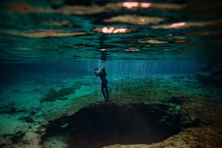 Freediving through the bubbles and caves in the crystal waters of Ginnie Springs...