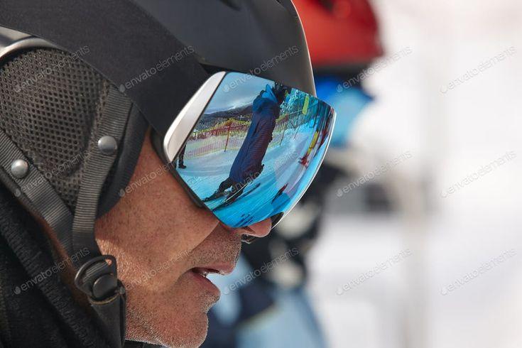 Ski goggles on a white winter landscape. Blue reflection. Horizontal By ABBPhoto...