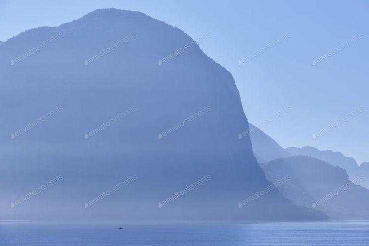 Norwegian fjord landscape sunrise in blue tone. Fisherman solitude. Horizontal B...
